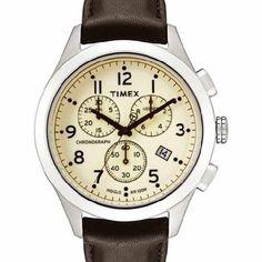 Timex serie T. Cronografo y tres esferas: décimas de segundo, segundos a las 6, 30 minutos a las 10. Fecha a las 4.