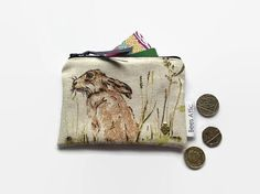 Coin Purse, Hare, Rabbit, credit card holder, cosmetics bag, jewellery pouch, gift card holder, A sweet little coin purse in a sweet hare fabric fabric. This purse measures approx 13.5cm by 9cm (5.25 by 3.5). It can hold coins, a few credit cards, ear phones for your phone, small items of make-up or any other small items you wish to keep safely together.  This purse is not padded.