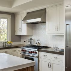 plain subway white tile but with a design behind stove