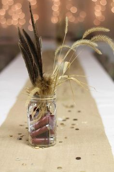 Easiest decoration ever! Feathers, weeds, & shotgun shells all in a mason jar!