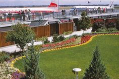 Stapelton Airport Denver 1958... I was always caught off-guard by this garden at Stapleton while racing to the Observation Deck with my dime. What a fantastic photo of memories... of props!!!