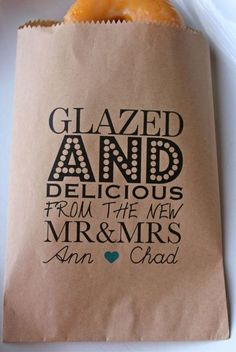 If you are having a modern wedding and haven't chosen your favor yet, have you considered donuts?| See more wedding favor bags and boxes here: http://www.mywedding.com/articles/wedding-favor-bages-and-boxes/
