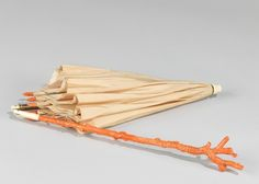 Carved coral was a very popular material for parasol handles in the 1850s and 60s.
