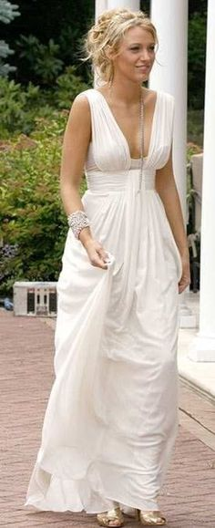 Another gorgeous wedding dress. I would like this with a higher neckline.