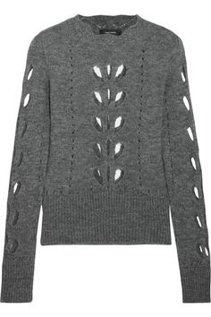 Isabel Marant's 'Ilia' pointelle-knit sweater is spun with touches of alpaca and mohair for a sumptuous handle. Part of the punk-inspired Fall '16 collection, this slim-fitting piece is detailed with teardrop cutouts and a scalloped neckline. Echo the runway styling and team yours with a leather skirt and boots.