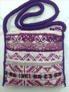 Reverse of purple purse.Debbie Irving