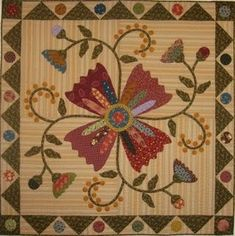 Kim Diehl design. But I have a old quilt book I found recently that has this pattern.  It was based on an antique crib quilt.