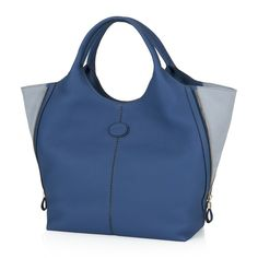 Medium shopping bag crafted in soft naturally grainy leather, with exposed stitching, side zip with leather slides, nubuck panels, magnetic fastening, lined interiors and twin handles.