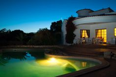 Luxury pool lit up at night - perfect spot for a party