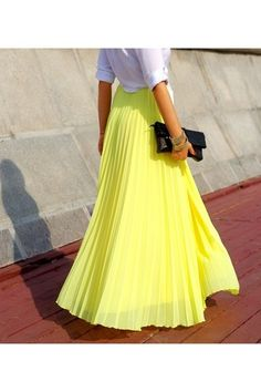 Pleated skirts are very feminine. Choose a colour that works for you :)