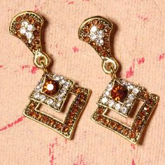 Earrings with Tiny Orange Crystals are really exclusive and classy. The contour of the earrings looks perfectly special and very womanly. So, girls what are you waiting for grab it now!!!      Fashion Statement      You may try these earrings with saris and suits.