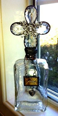 "Bottle soldered with chandelier crystals, vintage jewelry and soldered ""love"" charm"