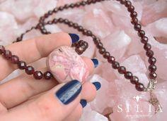 Rhodochrosite Pendant in Garnet beaded necklace on Rose Quartz background Gems Jewelry, Beaded Jewelry, Beaded Necklace, Pendant Necklace, Gem S, Crystal Healing, Gemstone Beads, Rose Quartz, Garnet