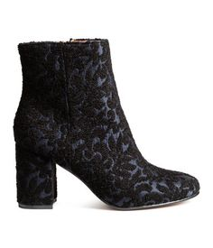 Black/dark blue. Boots with an embroidered pattern, side zip, and covered heels. Satin lining, satin insoles, and rubber soles. Heel height 3 1/4 in.