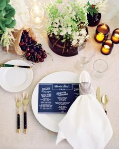 Tablescapes were decorated with paper sacks of ripe red cherries, amber glass vessels, and floral arrangements. The bride used ticking stripes as napkin holders and for servers' aprons.