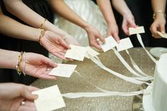 With wedding season underway, we're highlighting a popular Southern wedding tradition involving our favorite dessert—the cake pull, as well as the meaning behind those good-luck charms. Diy Wedding On A Budget, Wedding Tips, Wedding Events, Wedding Planning, Tulle Flowers, Eat Pray Love, Southern Weddings, Bridal Beauty, Wedding Guest Book