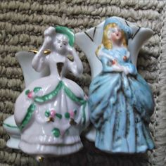 Here are two vintage porcelain German fairing vases with Victorian style ladies.  One is a beautiful  blonde haired lady dressed in blue with a blue
