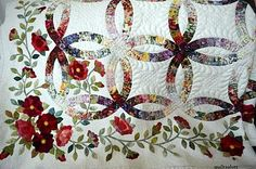Stunning quilt -- beautiful piecing, color, applique and hand quilting -- everytime I see this quilt I love it more.
