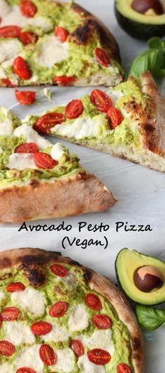 Homemade Neapolitan pizza crust topped with creamy avocado pesto, dairy free/vegan fresh mozzarella cheese, and tomatoes!