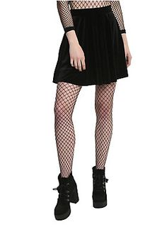 """Yes, it has pockets! Your new go-to goth skirt has an elastic waistband and velvet finish. This black skater skirt is anything but basic.<div><br></div><div><ul><li style=""""list-style-position: inside !important; list-style-type: disc !important"""">95% polyester, 5% spandex</li><li style=""""list-style-position: inside !important; list-style-type: disc !important"""">Wash cold; dry flat</li><li style=""""list-style-position: inside !important; list-style-type: disc !important"""">Size small approx. 18""""…"""