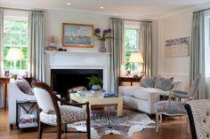 furniture plan, blues and blacks, neutrals, animal prints, floors ,demilunes flanking windows, drapes:
