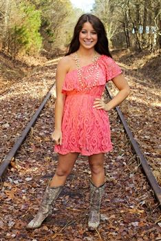coral lace dress, cowboy boots. Want this dress! Maybe with a denim jacket