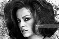 'Close up of an enigmatica Virna Lisi, with dark brown hair, taken against an old stone wall; the photoshoot is taken in a little village on the Roman hills, in the valley of the Aniene River, setting of her last movie, The Secret of Santa Vittoria. Anticoli Corrado (Rome), Italy, 1969. (Photo by Marisa Rastellini\Mondadori Portfolio via Getty Images)'