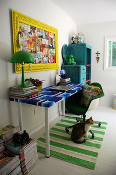 Surround yourself with what you love. For all the cat lover's out their. Kitties in the workplace/ office.