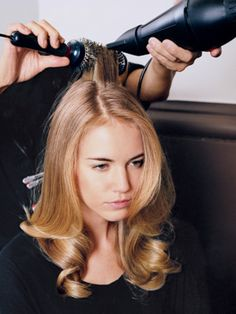 Ways to Fake a Blowout: The FlatIron–Round Brush Method. First, revive limp hair with a spritz of dry shampoo or aerosol volumizer, like Tigi Bed Head Superstar Queen for a Day. Then, run a two-inch section of hair through a flatiron and immediately pull the same section through a round brush. This will add volume at the root and give the hair a slight bend at the ends.