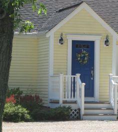 blue door, yellow house
