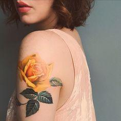 yellow rose arm tattoo