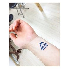 Valknut tattoo on the left wrist. Tattoo artist: Banul