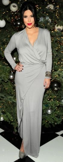 Who made Kim Kardashian's gray long sleeve wrap dress and platform pumps that she wore in Los Angeles on December 24, 2011? Shoes – Yves Saint Laurent  Dress – Mason By Michelle Mason