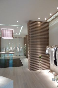 Clothing Store Interior Design Ideas Pinned by… Clothing Store Interior, Boutique Interior, Shop Interior Design, Retail Design, Store Design, Interior Ideas, Visual Merchandising, White Leather Ottoman, Modern Store