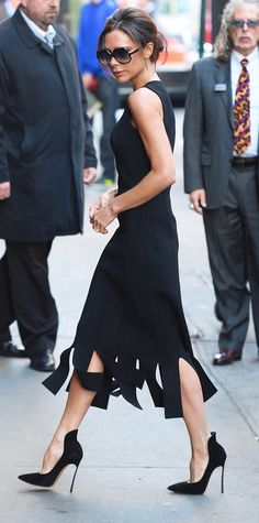 Carwash pleated skirts were all over the runways (including Beckham's own resort collection), but instead of following the fashion herd, she remained true to her posh aesthetic, rocking the trend with a classic LBD and black pumps.