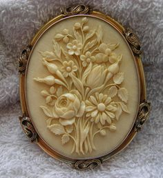 Victorian Ivory Cameo of a Bouquet of Flowers in 15k Gold Frame, France, c. 1860-1870.  I love this.