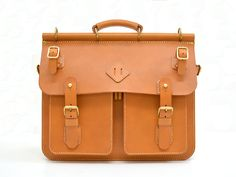 .Herz Japan - less formal leather briefcase with umbrella straps.