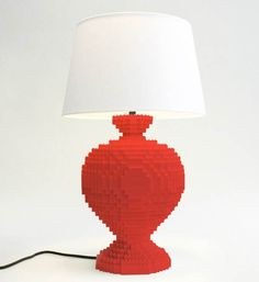 """When design meets LEGO bricks! The designer Sean Kenney, certified by LEGO as """"professional builder"""" (yes, this exists!), has designed this beautiful series of table lamps made from colorful bricks. Some lamps with pixelated curves which unfortunately are relatively expensive since it will cost you between $695 and $895 each…"""