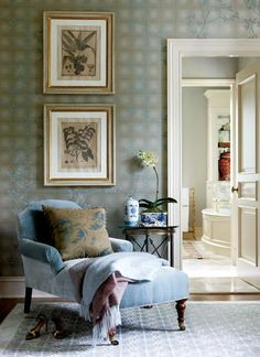 In the dressing room, Chinoiserie wallpaper, blue and white Chinese porcelain, and a glimpse of a ginger jar and a faux bamboo towel rack in the bathroom.