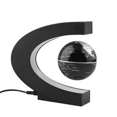 New Rotating Magnetic Levitation Floating Black Globe Map C Shape LED Light Base. This product are composed of floating globe and C shape base. Globe levitates with electromagnetic technology, levitates in mid air!