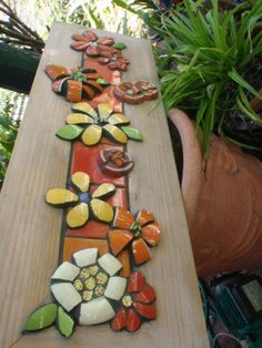 Long flower panel  by Poppins Mosaics and Crafts, via Flickr