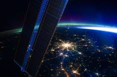 Recent image from the orbiting International Space Station. A stunning view of the planet at night from an altitude of 240 miles, it was recorded on March 28. The lights of Moscow, Russia are near picture center and one of the station's solar panel arrays is on the left. Aurora and the glare of sunlight lie along the planet's gently curving horizon. Stars above the horizon include the compact Pleiades star cluster, immersed in the auroral glow.
