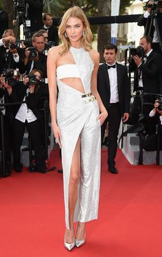 Karlie Kloss embraced the jumpsuit trend at the Cannes Film Festival in Versace. The model's outfit is a great lesson on how-to wear a jumpsuit. Throw on a pair of heels and the look is a great summer wedding outfit. Are you excited for more Cannes fashion?