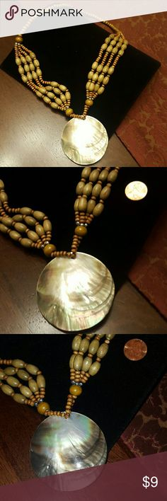 """ABALONE SHELL NECKLACE 24"""" Abalone shell necklace with wooden beads.  The shell is 2 1/2"""" x 2 1/2"""".  Maximize your savings by bundling. Jewelry Necklaces"""