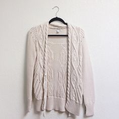 Banana Republic tie front cardigan Cream colored knit cardigan sweater from banana. Ribbon tie in front. Wear tied or untied easily. Banana Republic Sweaters Cardigans
