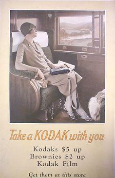 "c. 1922. In-store sign. ""Take a Kodak with you."" Kodaks. Brownies. Kodak Film. Get them at this store."