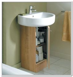 corner pedestal sinks for small bathrooms pedestal sink storage with space saving features homes intended for narrow pedestal sink plan interior bathroom sinks small corner pedestal sinks for small ba Pedestal Sink Storage, Bathroom Sink Storage, Kitchen Wall Storage, Small Bathroom Sinks, Kitchen Sink Organization, Under Sink Storage, Diy Storage, Storage Ideas, Sink Organizer