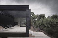 Black house with black butterfly chairs