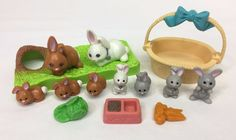 Overall in good, used condition.  Not complete, but does include some extra bunnies.  May have minor general wear, paint flaws, small marks, slight discoloration, and/or other little imperfections.  One sitting gray bunny has a spot of green paint on its back, and please note that the white adult bunny is from the board game and not magnetic.  Please see photos for further details.<br/><br/>White adult bunny is from the board game, so it's not magnetic. One sitting gray bunny has a ...