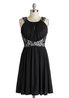 Moonlit Gathering Dress from Modcloth.  I'm not normally drawn to black dresses, but this is beautiful.